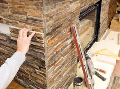 Tile Worker Placing Stacked Stone Piece for a Fireplace Surround Stone Veneer Fireplace, Cozy Fireplace, Fireplace Surrounds, Fireplace Remodel, Diy Frame, Art And Architecture, Natural Stones, Interior Decorating, Stock Photos