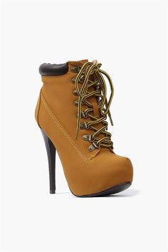 Jo Jo Boots - Tan A great pair of designer inspired boots! These boots have a great heel with all around coverage and lace up detailing.
