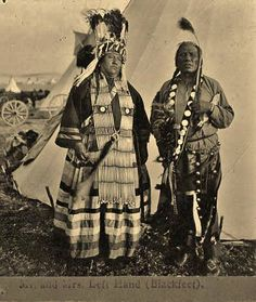 Mrs. Left Hand (on the left) with her husband, Left Hand (on the right) - Blackfeet (Pikuni) - circa 1908
