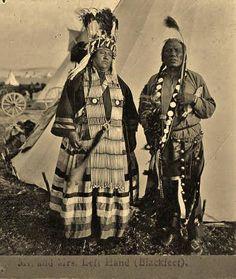 Mrs. Left Hand (on the left) with her husband, Left Hand (on the right) - Blackfeet (Pikuni) - circa 1908