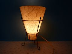 Mid Century Modern Tripod Lamp Fiberglass Shade With Gold Swirls Modern Atomic. $35.00, via Etsy.