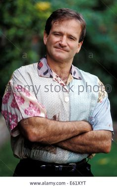 FILE PIX: Actor and comedian Robin Williams has been found dead in his California home in a suspected suicide, according to the Marin County Sheriff's Office, He was 63. PICTURED:Jun 19, 1991; San Francisco, CA, USA; Actor ROBIN WILLIAMS at home in San Francisco. © ZUMA Press, Inc./Alamy Live News Stock Photo