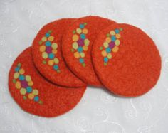 Handmade Orange Wool Felted Coasters with a Colorful Needle Felted Design