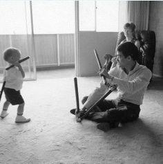 Bruce Lee teaching his son nunchucks