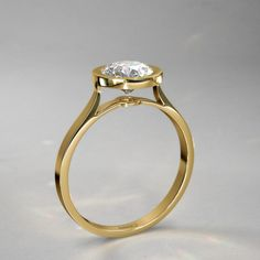 Exceptional Bezel Set Round Diamond Engagement Ring in 14k Yellow Gold