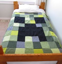 Free knitting pattern for Minecraft Creeper Blanket - Katherine Youngs designed this easy blanket of 100 squares of 7 shades of yarn.