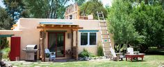 This modern studio cottage camping rental is located in Taos, New Mexico, and is perfect for glamping. Taos New Mexico, Land Of Enchantment, Rooftop Terrace, Camping Essentials, Tent, Pergola, Cottage, Outdoor Structures, Vacation