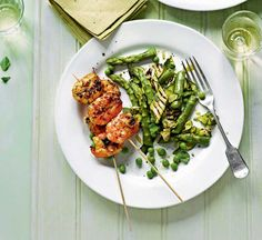 Sizzling prawns with warm courgette salad