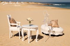 Stunning wedding ceremony on the beach in Cabo designed by Suzanne Morel. Flowers by Cabo Floral Studio. Furnitures Denni's Catering.