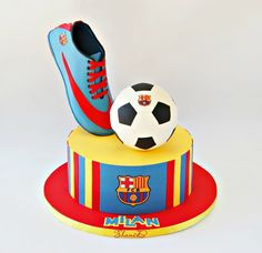 Chocolate mud cake ,chocolate ganache ,fondant stripes.Soccer boot  was made...