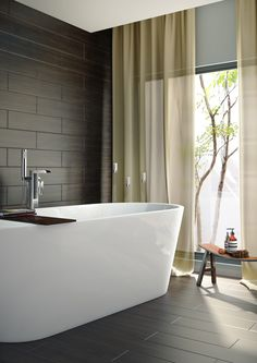 Dark wood effect tiles are used on both the wall and floor of this dramatic bathroom setting
