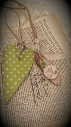 Green spotty rustic long heart gift tag or tree decoration