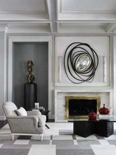 living room with coffered ceiling, contemporary fireplace, checkered grey carpet, and abstract mirror