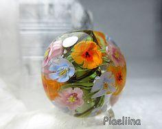 Round handmade focal bead. Handmade flower murrini by Pia Lähteenmäki