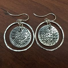 Lovely sterling silver circle disc earrings with fine silver surrounding circle. These earrings have lots of movement. I stamped the discs with