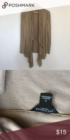 Ann Taylor Cardigan This is soft and stretchy and it is my favorite way to layer! This will add grace and flow to any tank or Blouse you have in your closet! It has a great detailed shoulder too!! Ann Taylor Sweaters Cardigans