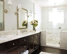 The white marble on top of the dark vanity is so eye catching and rich looking