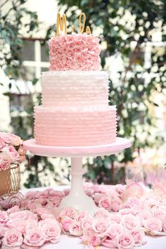 Wow! Ruffled and layered ombre pink cake for the bridal shower or the wedding…