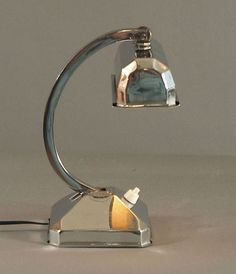 A French Chrome Art Deco Table or Desk Lamp, Articulated | From a unique collection of antique and modern table lamps at https://www.1stdibs.com/furniture/lighting/table-lamps/