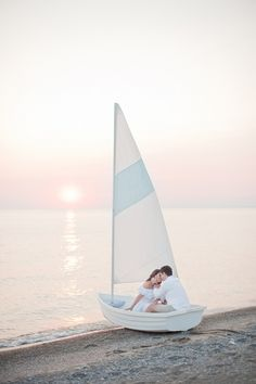 sailing at sunset engagement session