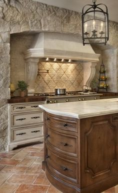 Glazed cabinets, natural stone, cool lighting