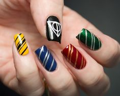 Harry Potter nails.. The 4 houses, and the hallows