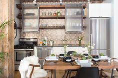 Absolutely swooning over this kitchen. It may be small, but that cement tile and the exposed shelving unit really make it pop.