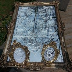 Mirror seating charts with matching mirror table numbers.  www.happilyeveraftereventsinc.ca