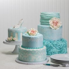 "Vintage Romance turns something blue into beautiful, with rich textures and elegant edible lace. Main cake as shown: 10"" (Tall Tier) X 8"" (Tall Tier) X 6"" round layers. Serves 130 (including top tier)."