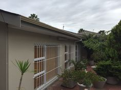 External redecoration with white burglar bars, seamless gutters and nutec fascia boards