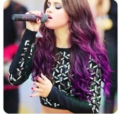 The purple hair looks gorgg on her :*