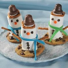 kids christmas party dessert food marshmallow snowmen on cookie sled