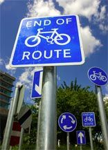 michael pinsky, collection of roadsigns for a roundabout in ashford, kent. later removed due to motorists' complaints.