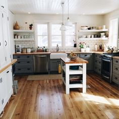 I love the butcher block countertops and dark grout subway tile in this country kitchen DREAM KITCHEN Country Kitchen, New Kitchen, Kitchen Decor, Kitchen Interior, Eclectic Kitchen, Kitchen Ideas, Rustic Kitchen, Kitchen Black, Stylish Kitchen