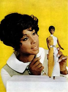 Promotional image of American actor Diahann Carroll with the talking doll made in the image of her character on the the NBC television series Julia, United States, 1968, by Mattel, Inc.