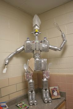 This 5 ft. tall robot is made completely from plastic jugs and bottles Recycling. This 5 ft. tall robot is made completely from plastic jugs and bottles Recycling. This 5 ft. Recycled Robot, Recycled Crafts, Gadgets And Gizmos Vbs, Cultura Maker, Maker Fun Factory Vbs, Plastic Jugs, Vbs Themes, Household Chores, Recycled Bottles