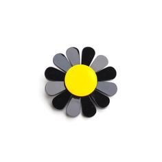 Description Celebrate the arrival of spring with the electric coloured daisy brooch. Bold blooms are laser cut in thick black and yellow perspex that will brighten up your look in an instant. Pair with a patterned dress for a total flower power look.  Measurement 7x7 cm across