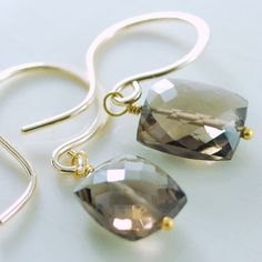 Smoky quartz stones in a rectangle, or cushion cut. Gorgeous quality in a simple, pretty style.