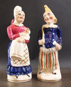 A pair of Staffordshire slip cast porcelainous 'Punch
