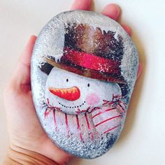 Snowman painted on rock                                                                                                                                                                                 More