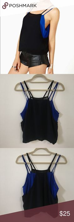 Nasty Gal Black And Blue Double Layer Tank Top Nasty Gal Black And Blue double layer tank top! This tank top is so cool and looks adorable on with black or blue skinny denim jeans and boots! Perfect for the transition from summer to fall! Only worn once and in very EUC! No signs of damage or wear or stains, it is perfect! Nasty Gal Tops Tank Tops