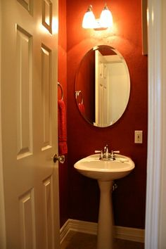 Want to re-do my powder room in lipstick red. Have white pedestal sink and white toilet. Hardwood floor.