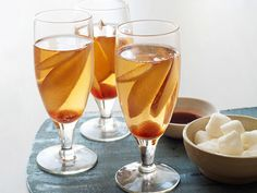 Champagne gets a cozy makeover with pears and brandy in this autumn cocktail.