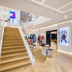rpa:group's Interior Architecture division has designed Tommy Hilfiger's re-opened premium concept store on Amsterdam's Hoofstraat. Tommy Hilfiger Store, Tommy Hilfiger Fashion, Light Oak Floors, Hanging Rail, Bar Areas, Art Deco Period, Retail Space, White Space, Herringbone Pattern