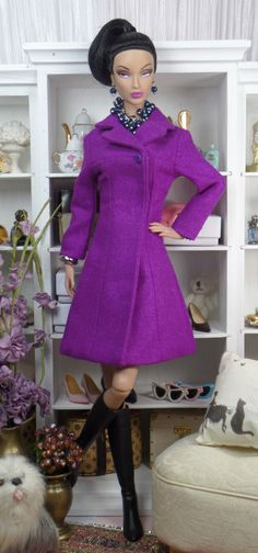 This classic yoke style coat PDF pattern for 12 or 16 inch dolls can be found under coats, jackets and capes to the right of the blog. Thanks.