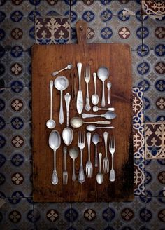 Silverware art....an idea for the dining room - Barbara, neat idea to put it on a wooden cutting board, huh? Also, little less formal than shadow box.