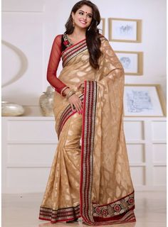 Create an ambiance of fashion and grace wearing this fab beige brasso georgette party wear saree. This attire is crafted with stylish patch border work, resham embroidery and stone work....
