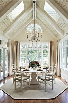 Cottage Dining Room with Exposed beams, Hardwood floors, French doors