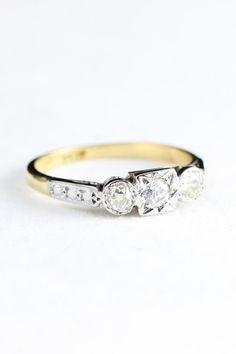 Art deco 3 stone old cut diamond art deco engagement ring in 18 carat gold and platinum