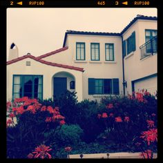 """Turquoise and Orange Home I loved on Shoreline Drive. Those flowers I learned are called """"Aloe's."""""""
